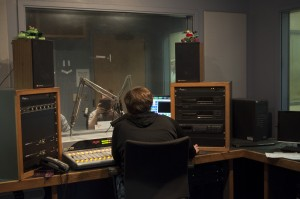 Heath Howard helps produce Capstone News Now, the radio's daily news program